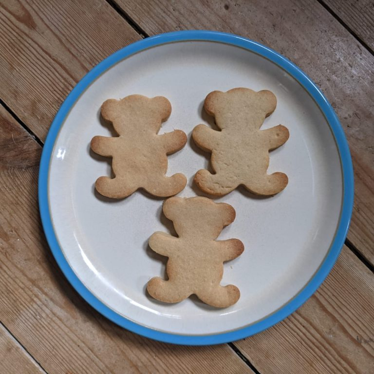 shortbread biscuits on a plate. Shaped like bears.
